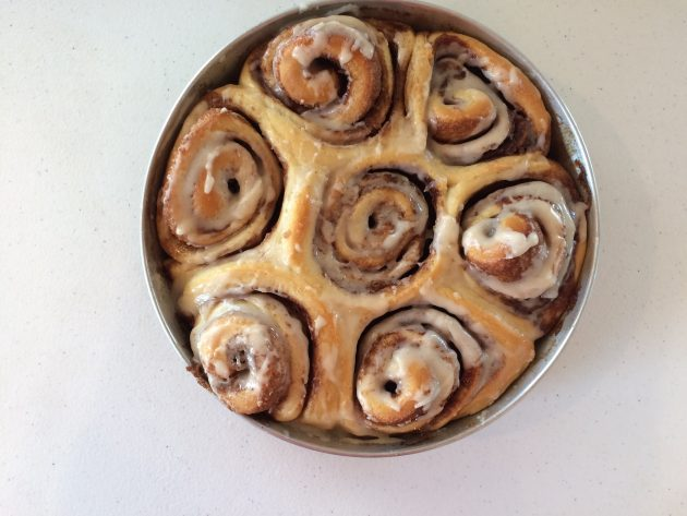 cinnamon rolls with icing in pan