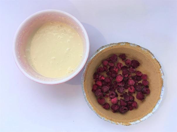 Fresh raspberries in pie crust with filling on side