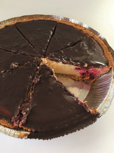 Raspberry Cheesecake Pie with slice cut out