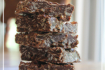 Looking for clean eating, real food snack ideas? These no-bake bars are the bomb -- plus they're packed with nutritional goodness! There's only one problem: it's near impossible to eat just one!