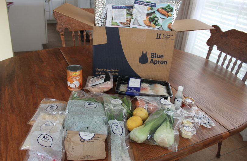 ingredients from Blue Apron box on kitchen table