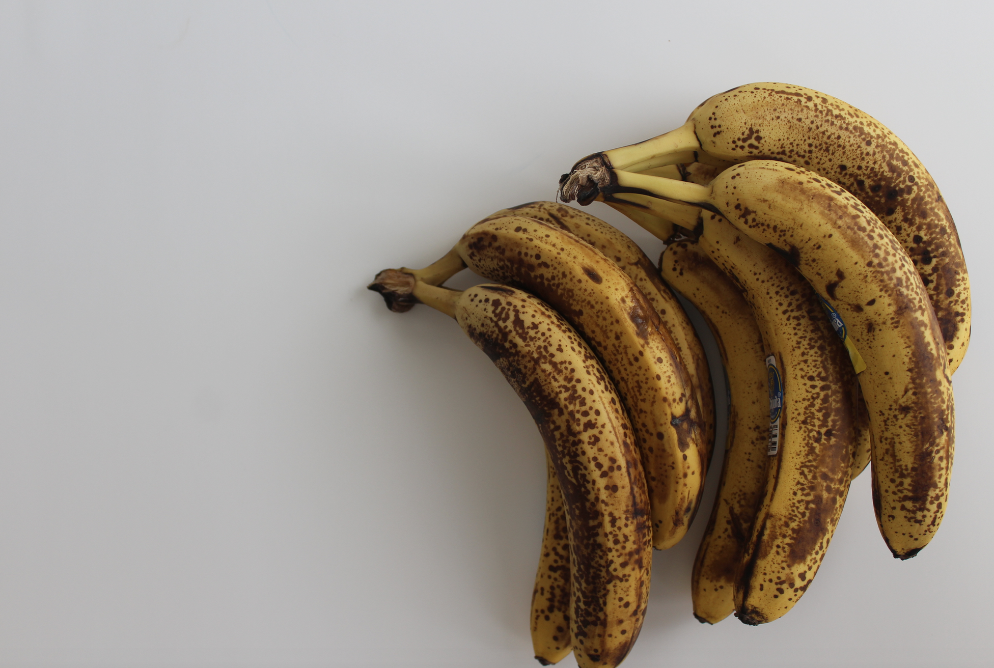 ripe bananas on white counter