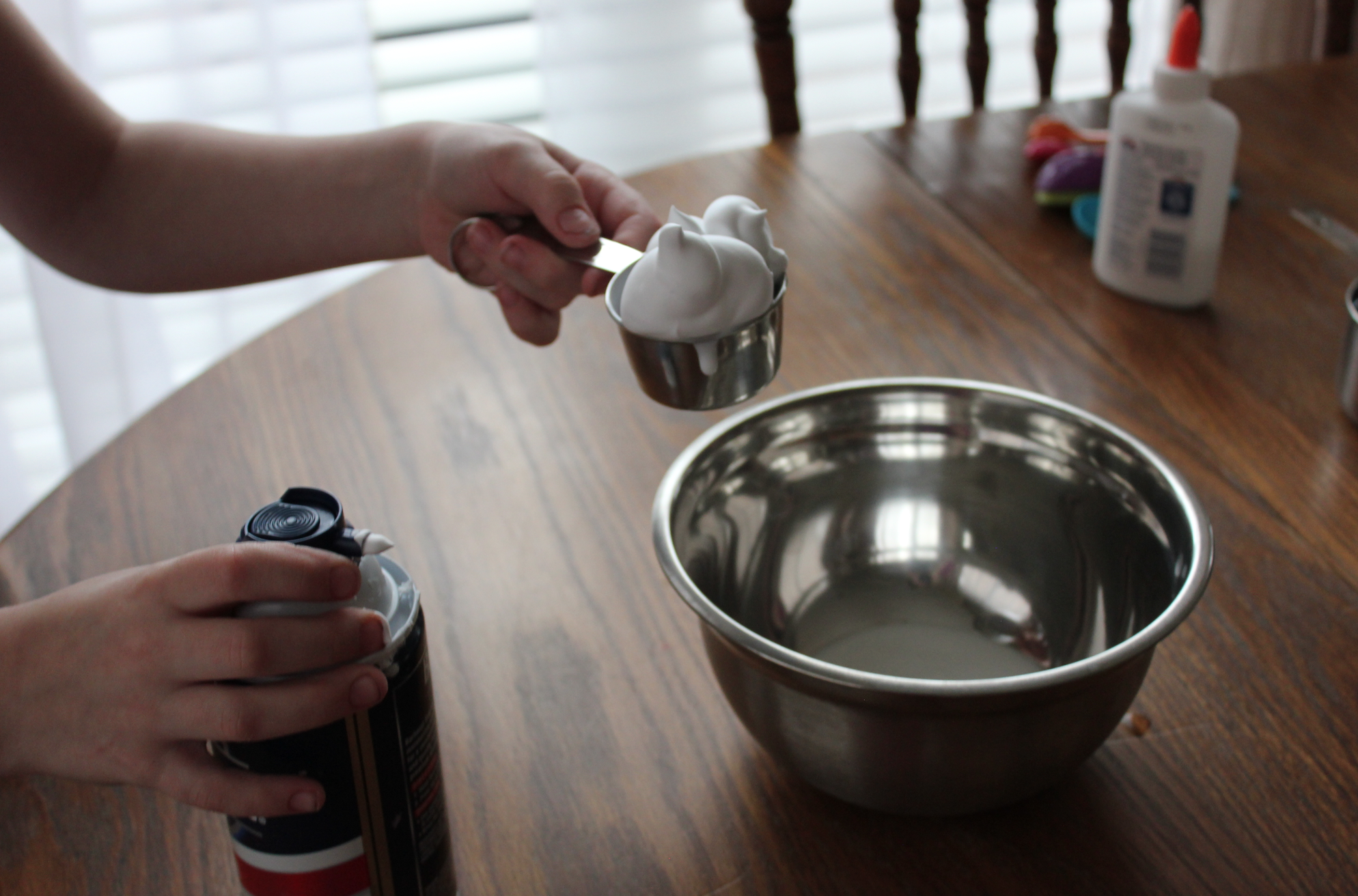 How to make homemade slime money saving mom now add one fourth a cup of glue shaving cream foaming hand soap and a few squirts of liquid hand soap to the bowl mix well ccuart Choice Image