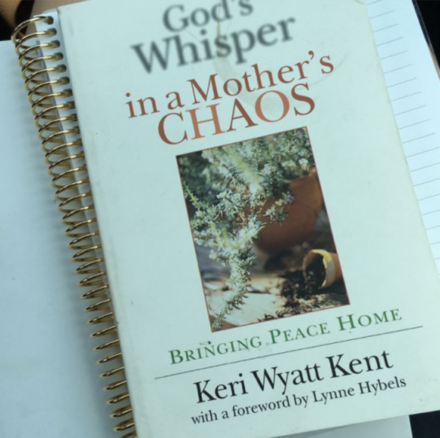 close-up photo of God's Whisper in a Mother's Chaos book