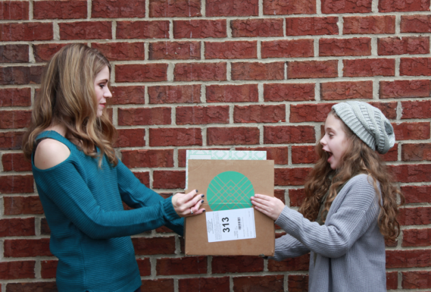 mom and daughter holding Stitch Fix box