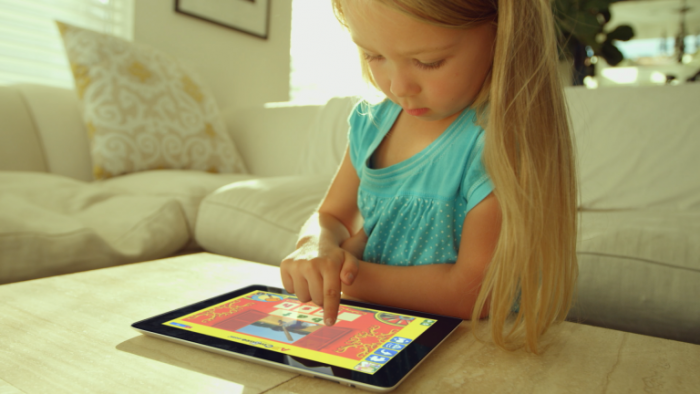young child using ABCmouse educational app on iPad