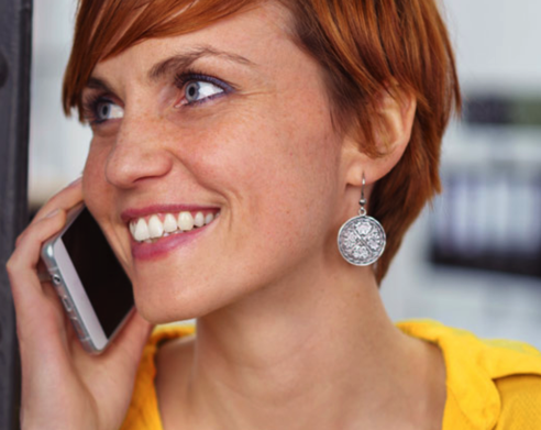 Woman Using Twigby Cell Phone