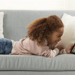 Girl on couch using FreeTime Unlimited