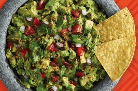 Guacamole in a Bowl with Chip
