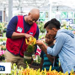 Lowe's employee helping customers in garden center