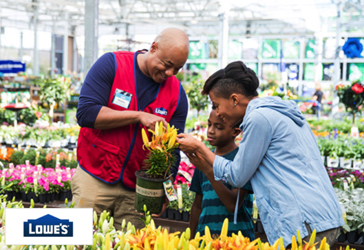 Lowe's employee helping customers in garden center