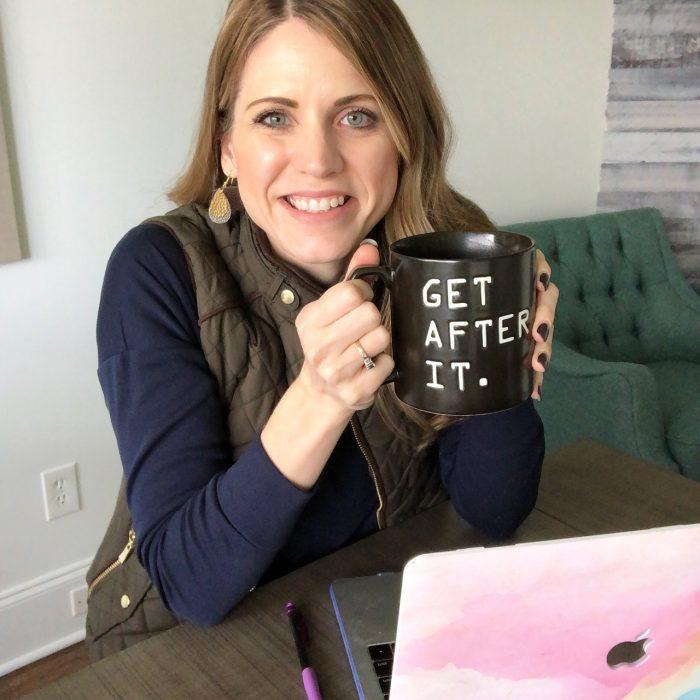 Crystal Paine holding Get After It coffee mug
