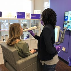 A woman getting a smile direct club scan