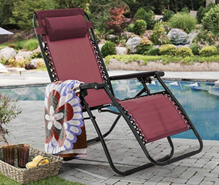 red zero gravity chair by the pool