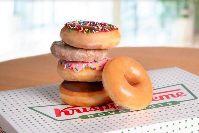 pile of krispy kreme doughnuts