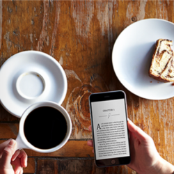 using a kindle with coffee and pastry
