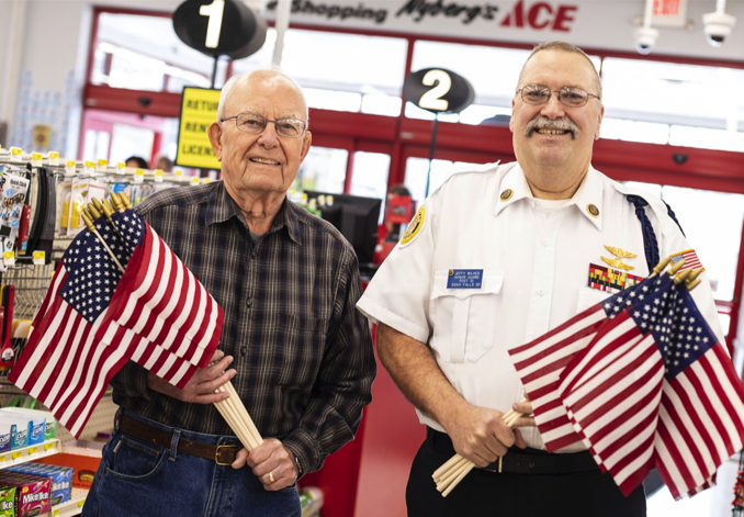 veterans with American flags at Ace Hardware