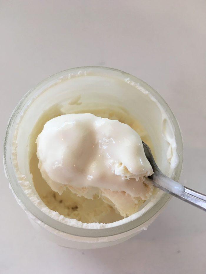 ice cream on a spoon from a mason jar
