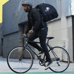 Postmates Driver on Bicycle