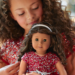 Girl and American Girl Doll