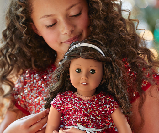 Girl and American Girl Doll