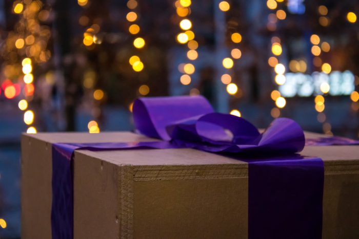 Gift box with purple bow