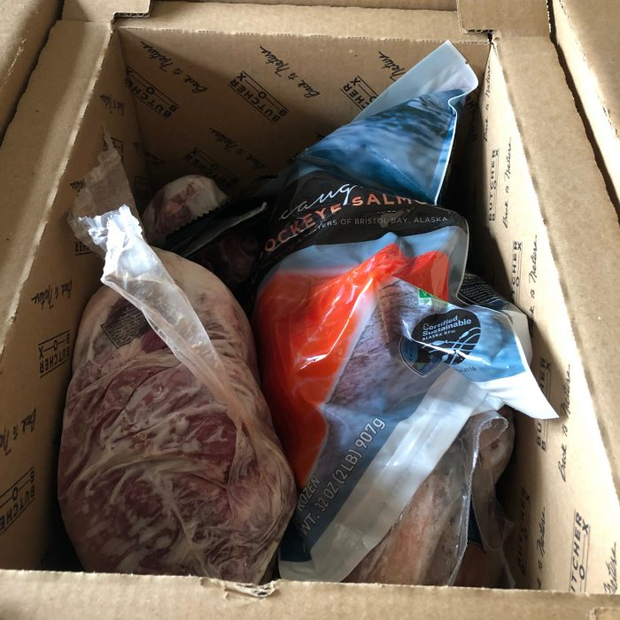 salmon and meat in a box