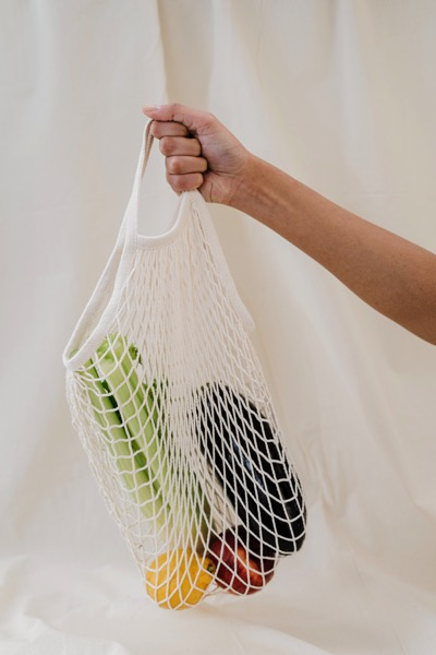 Person holding produce bag