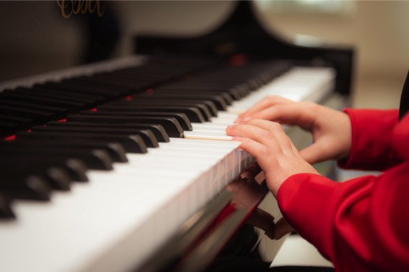 little kid hands playing piano