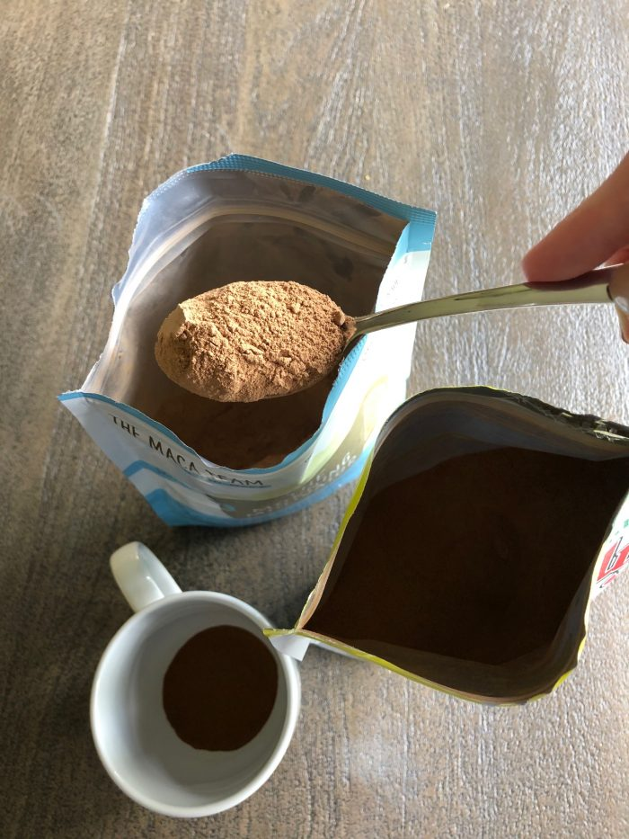 scooping maca blend into cup