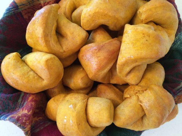 pumpkin crescent rolls in a bread basket