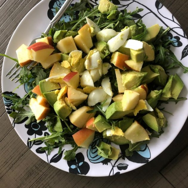 huge salad with apples and avocado