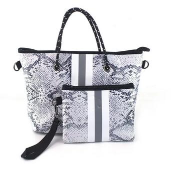 Neoprene Handbag & Wristlet only $44.99 shipped!